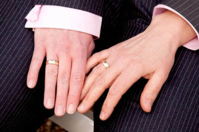 Gay Couple showing wedding rings